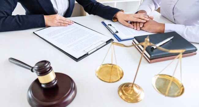 Professional Female lawyer discussing negotiation legal case with client meeting with document contact in courtroom, law and justice concept.